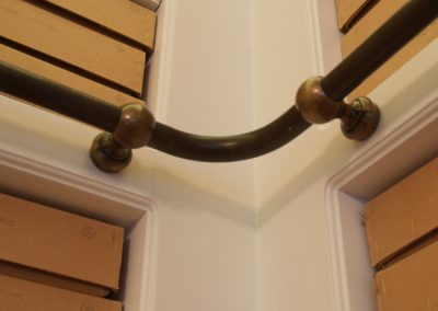 Bespoke bronze hook-on library ladder rail
