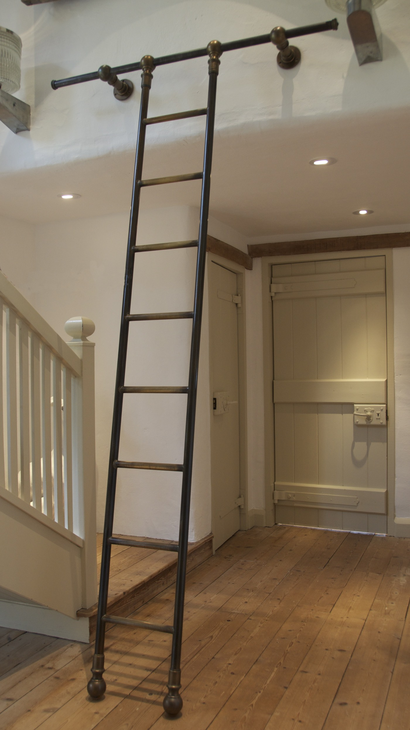 bespoke rolling library ladder finished in bronze