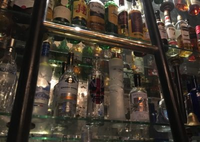 A bespoke library ladder for pub bar spirit display system