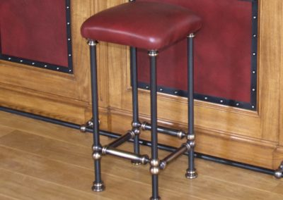 AND bespoke leather steel and bronze bar stools