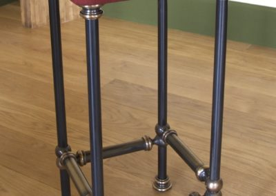 AND bespoke made leather steel and bronze bar stools