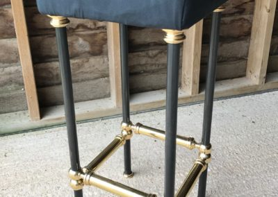 AND bespoke steel and polished brass bar stool design with illustrative seat cushion