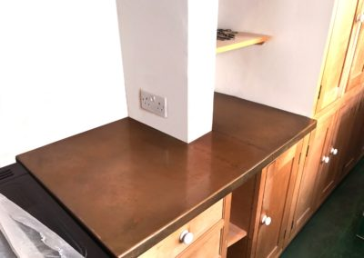 Andrew Nebbett Designs antique patinated copper kitchen worktop custom made to fit