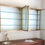 Andrew Nebbett Designs custom made antique brass and glass wall mounted cabinet