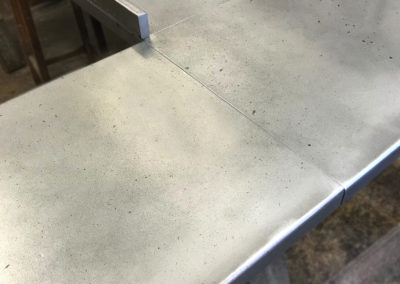 Andrew Nebbett Designs bespoke antique patinated zinc worktop for island unit with upstand