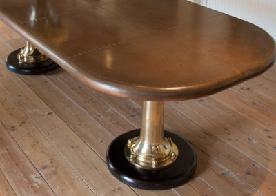 Andrew Nebbett Designs bespoke marine style copper table with ship telegraph legs