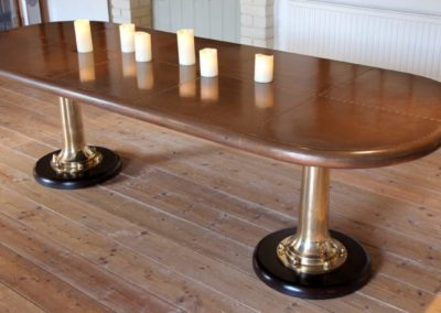 Andrew Nebbett Designs bespoke marine style copper table with ship's telegraph legs