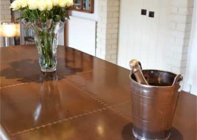 Andrew Nebbett Designs bespoke marine style patinated copper dining table