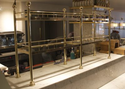 AND solid brass partition shelving