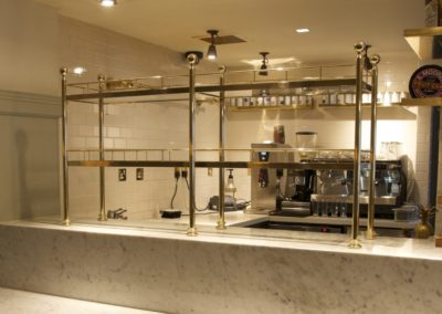 AND solid polished brass partition shelving