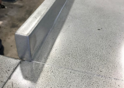 Andrew Nebbett Designs bespoke zinc worktop for island unit with upstand