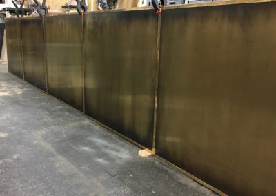 AND custom brass panels for commercial bar surround