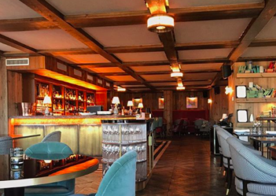 Handmade patinated brass wall cladding for commercial bar surround
