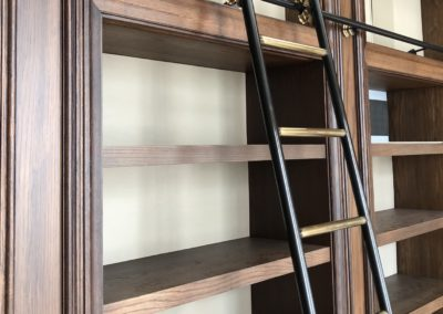 Andrew Nebbett Designs bespoke made & designed rolling library ladder systems