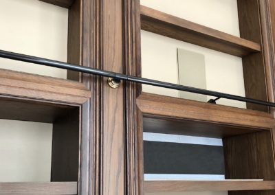 Andrew Nebbett Designs custom brass and steel rolling ladder system and hardware