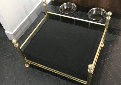 Andrew Nebbett Designs solid brushed brass dog bed with upholstered dog bed as at Christopher Peacock London