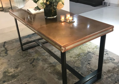 Andrew Nebbett Designs bespoke copper top table with polished nickel plate detailing and steel base featured at Christopher Peacock London