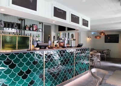 Brass and glass screen by Andrew Nebbett Designs for The Red Lion Clovelly